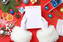 Santa Claus Holding Paper And ...