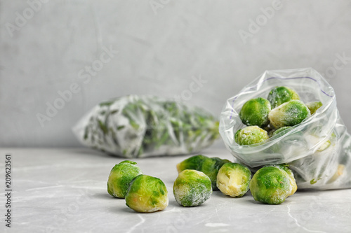 Door stickers Brussels Plastic bag with frozen Brussel sprouts on table. Vegetable preservation