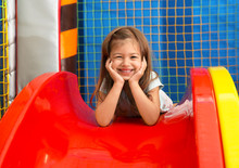 Little Girl Riding On Slide In Entertainment Center