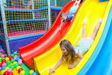 Cute Children Riding On Slide ...