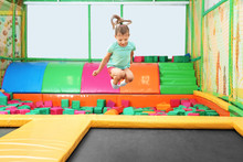 Cute Girl Jumping On Trampolin...