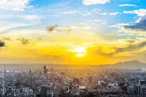 Asia Business concept for real estate and corporate construction - panoramic urban city skyline aerial view under twilight sky and golden sun in Taipei, Taiwan