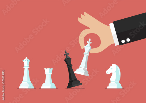 Canvas Print Businessman hand use white king checkmate the black king