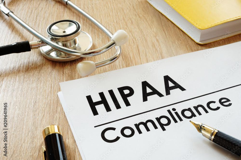 Fototapeta HIPAA Compliance application and stethoscope on a desk.