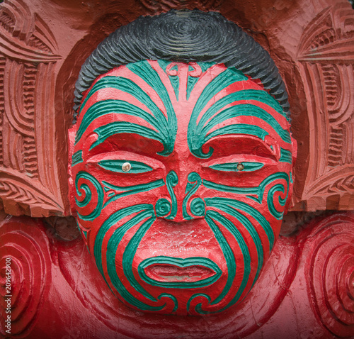 The cropped shot view of the traditional Maori wood carving statue in New Zealand.