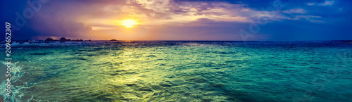 Photo Stands Green blue Sunset over the sea. Amazing landscape panorama
