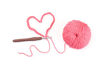 Ball Of Knitting Yarn With Crochet Hook On White Background