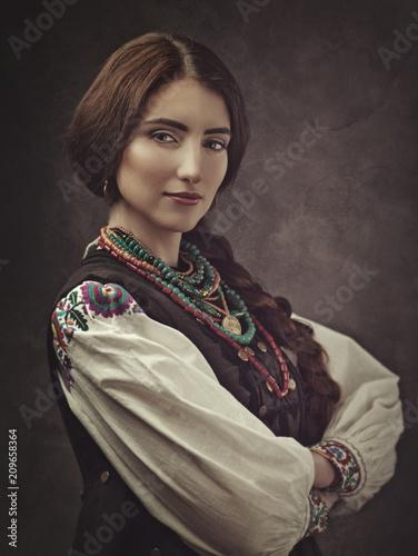 Ethno Beauty  Beautiful young woman in traditional ukrainian dress