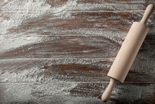 Scattered Flour With Rolling Pin On Wooden Background