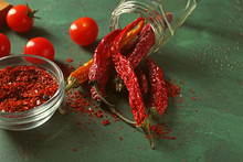 Overturned Glass Jar With Dried Chili Peppers On Table