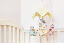 Close-up Baby Crib With Musica...