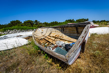 Old Abandoned Wrecked Fishing Boat At Ship Or Boat Graveyard.