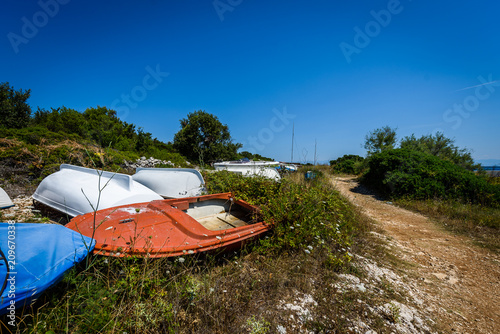 Foto op Aluminium Arctica Old abandoned wrecked fishing boat at ship or boat graveyard.