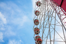 Underside View Of A Ferris Wheel On The Blue Sky Background