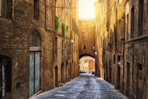 Old street in Siena, Tuscany, Italy. Siena architecture