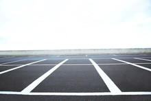 Empty Outdoor Parking Lot Space Marked With White Lines. Can Accommodate Car A Lot.