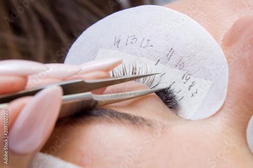 Slika na platnu Beautiful Woman with long lashes in a beauty salon