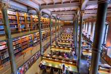 National Library Of Sweden With Students And Readers Under Historical Columns