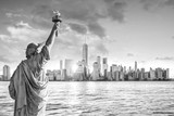 Fototapeta Nowy York - Statue Liberty and  New York city skyline black and white