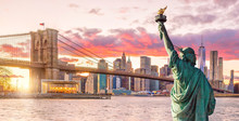 Statue Liberty And  New York City Skyline At Sunset