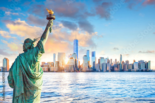 Photo sur Toile New York Statue Liberty and New York city skyline at sunset