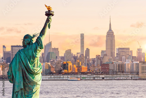 Statue Liberty and  New York city skyline at sunset - 209705595