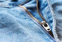 Close-up Of Blue Jeans Brass Zipper