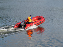 A Man Driving A Motor Boat. Lifeguard In A Life Jacket, Rescue Drowning, Safety On The Water, River Patrol