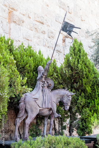 Fotobehang Artistiek mon. Fragment of the statue with two knights in the old city in Jerusalem near the Jaffa Gate