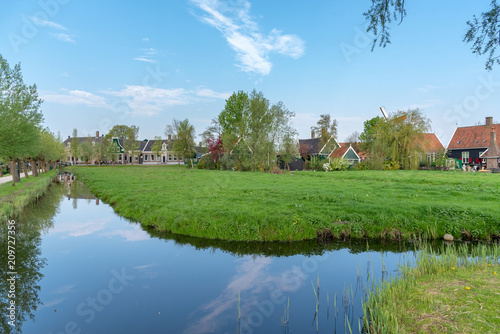 Staande foto Blauw rural scenery of old houses and canal in Zaanse Schans, Netherlands