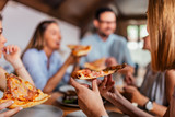 Eating pizza with friends. Close-up. - 209728154