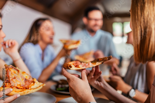 canvas print motiv - bnenin : Eating pizza with friends. Close-up.