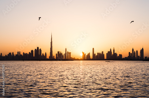 Poster Oceanië Panoramic view of Dubai cityscape at sunset