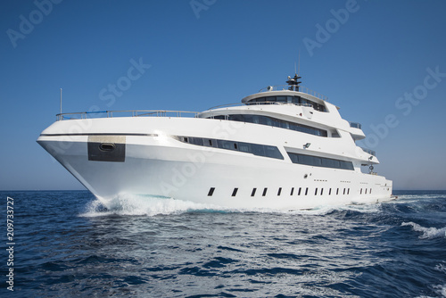 Luxury private motor yacht sailing at sea