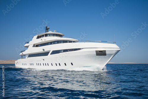 Luxury private motor yacht sailing at sea Fototapeta