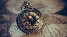 Antique Watch On Old World Map
