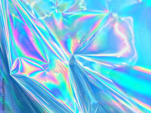 Fotografia Holographic background texture design of neon iridescent wrinkled blue foil surface