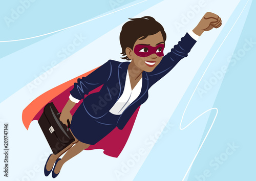 Photo  Young African-American superhero woman wearing business suit and cape, flying through air in superhero pose, on aqua background