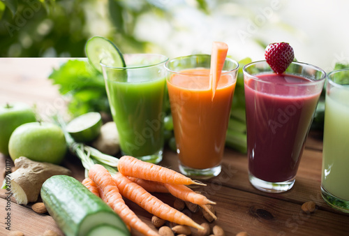 healthy eating, drinks, diet and detox concept - close up of glasses with differ Canvas Print