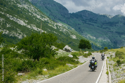 Papiers peints Alpes Tourists with motorbikes travel in the high mountain. Albania, Europe