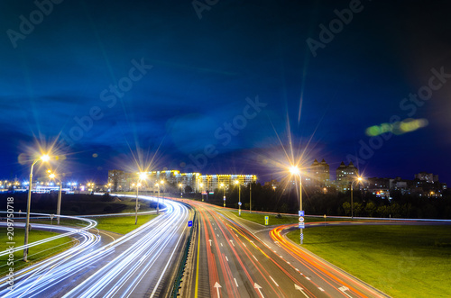 Fotomural Night Traffic with Light Trails on Highway Interchange