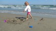 Child Playing on Beach, Little Girl Having Fun with a Sand Castle, Children
