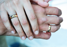 The Hands Of The Husband And Wife Are Linked By The Little Fingers