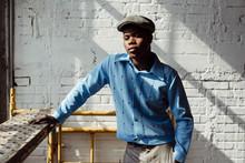 Stylish Black Man Near Brick W...