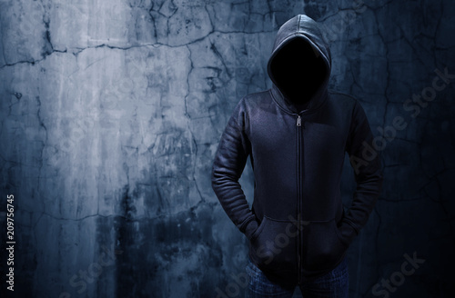 Hacker standing alone in dark room  Empty space for text or draw