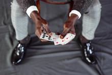 Crop Man Holding Playing Card