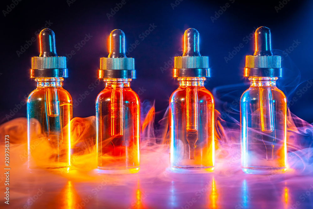 Fototapety, obrazy: A concept with an electronic cigarette. Vape. Bottles with liquid for electronic cigarette.  A concept Vape.