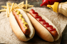Hot Dogs With Mustard And Ketchup On Wooden Table