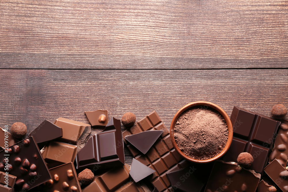 Fototapety, obrazy: Chocolate pieces with cocoa powder in bowl on wooden table