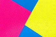 Pink blue and yellow color corrugated cardboard texture background. Trend colors, geometric cardboard paper background.